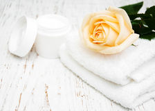 Rose with moisturiser cream and towels Royalty Free Stock Photography