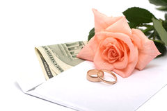 Rose, money and rings Royalty Free Stock Image