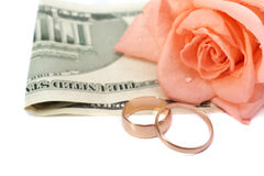 Rose, money and rings Royalty Free Stock Images