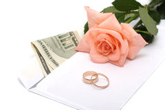 Rose, money and rings on a white background Stock Photography