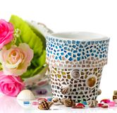 Rose and mosaic flower pot Stock Photography