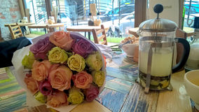 Rose multicolored bouquet on cafe table Stock Images