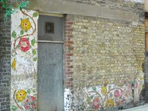 Rose Murals on an old wall in Rose Alley Southwark London Uk. The murals on the wall were once part of an old theatre called The Rose in Rose Alley near Bankside stock photos