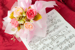 Rose on the musical notes Stock Photo