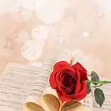 The rose on notebooks with notes Royalty Free Stock Image