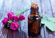 Rose oil in bottle Stock Image
