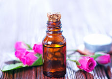 Rose oil in bottle Stock Photography
