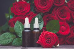Rose oil, Bottles and fresh flower and leaves on a natural background, bio, organic ,. Nature cosmetics concept royalty free stock photos