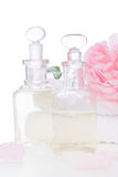 Rose oil with towels - isolated on white Stock Photos