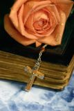 Rose old bible and cross Stock Photo
