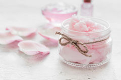 Rose organic cosmetics with salt, cream and oil on white table background Royalty Free Stock Photography