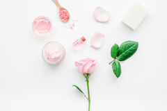 rose organic cosmetics with salt, cream and oil on white table background top view mock up stock image