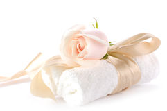 Rose over white towels. Creme rose over white towels Royalty Free Stock Photography