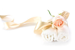 Rose over white towels. Creme rose over white towels Stock Photo