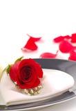 Rose på en matställeplatta Arkivfoto