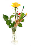 Rose and paintbrushes Royalty Free Stock Photography