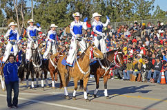 Rose Parade Cowgirls. Image of the All American Cowgirl Chicks in the 2015 Rose Parade.  Illustrates the equestrian entries in this annual event Stock Photo