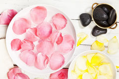 Rose patals and massage stones Stock Photo
