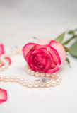 Rose, pearl and diamond ring Stock Photos