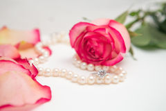 Rose, pearl and diamond ring. Rose, rose petal, pearl and diamond ring Stock Photography