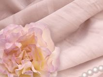 Rose and pearl on the natural silk Royalty Free Stock Photography