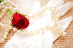 Rose and pearls with vintage glove. Red rose and pearls with vintage glove Stock Photo