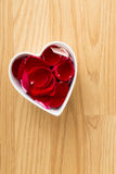 Rose pedal in heart bowl Royalty Free Stock Photos