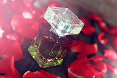 Rose perfume bottle and petal Royalty Free Stock Photo