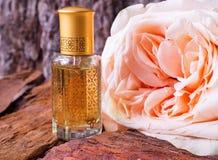 Rose perfumed oil. Arab perfume in mini bottles. Bottle of oil agarwood tree. Rose perfumed oil royalty free stock photography