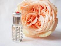 Rose perfumed oil. Arab perfume in mini bottles. Bottle of oil agarwood tree. Rose perfumed oil stock image