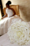 Rose Petal. A bride�s bouquet and bride in background Royalty Free Stock Photography