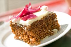 Rose petal cake. Carrot cake with rose petals on top Royalty Free Stock Images