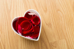 Rose petal in heart bowl Stock Image