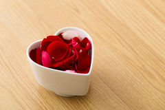 Rose petal in heart bowl Royalty Free Stock Photos