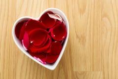 Rose petal in heart bowl Royalty Free Stock Photos