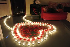 Rose petal heart path with candles Royalty Free Stock Images