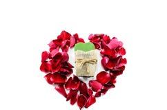 Rose Petal Heart. Heart of rose petals embracing green heart Stock Photo