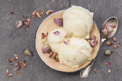 Rose Petal Ice Cream. Ice cream made with rose petal, cardamom, vanilla and pistachios royalty free stock images