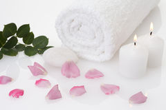 Rose petal spa. Petal, towel, and candle of rose Stock Photo