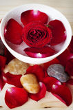 Rose petal spa. Rose and pebbles spa concept Royalty Free Stock Images