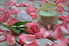 Rose petal spa. Scented candle, rose and rose petals Stock Photography