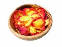 Rose petals. In a wooden bowl isolated on white background Stock Photo