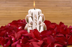 Rose Petals. Fragrant candle and hundreds of romantic red rose petals Royalty Free Stock Photos