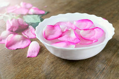 Rose petals. Bowl with water and rose petals stock photography