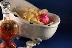 Rose petals and bath salts Stock Images