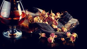 Rose petals on books and glass of wine. Royalty Free Stock Photos