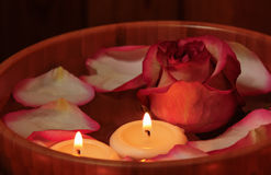 Rose petals, candles  and rose in bowl with water. Selective foc Stock Photography