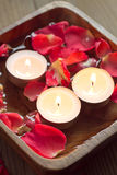 Rose petals with candles Stock Image