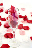 Rose Petals in Champagne Royalty Free Stock Images
