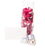 Rose petals in champagne flute with chocolates Royalty Free Stock Photo